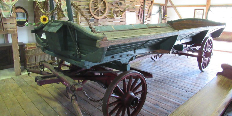 rustic farm wagon available for sale at an antiques auction