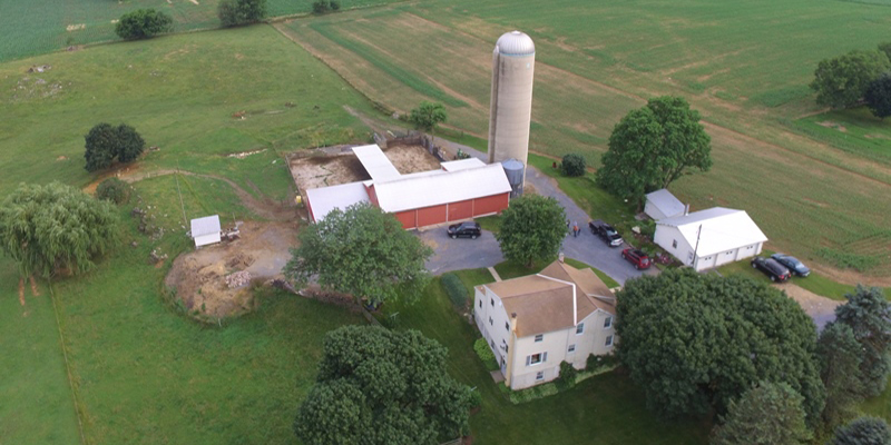 farm land with barn buildings and a home available at an auction