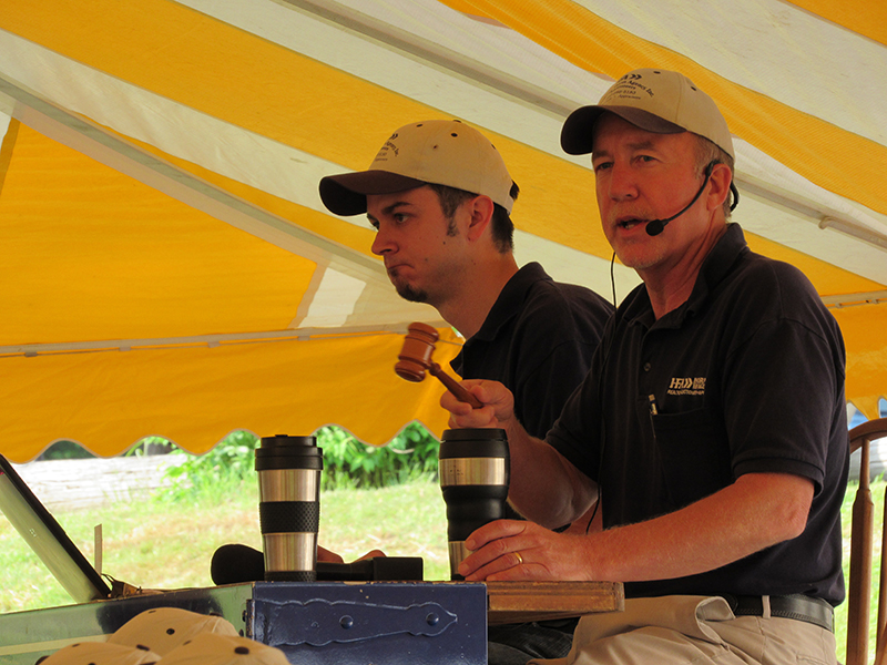 2 men working as auctioneers for a local pa auction